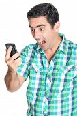 Excited man yelling at his mobile phone  (isolated on white)