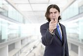 businessman in a suit pointing with his finger, at the office