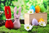 picture of ear candle  - Funny handmade Easter rabbits on green grass - JPG