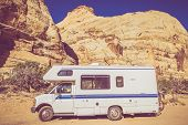 stock photo of camper  - Vintage Camper in Utah Sandstone Canyon - JPG