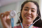 Portrait of female nurse with stethoscope