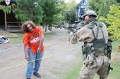 MUSKOGEE, OK - Sept. 13: Soldiers dressed in camouflage hunt zombies during the Castle Zombie Run at
