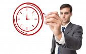 Composite image of business person drawing a clock on white background