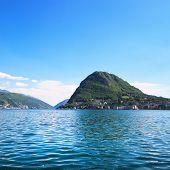 Lugano Lake And Mountains Landscape. Ticino, Swiss, Europe.