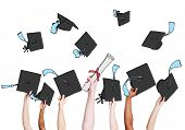 Group of Graduating Student's Hands Holding and Throwing Mortar Board