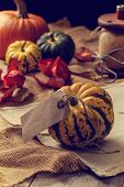Thanksgiving table with pumpkins and autumn leaves
