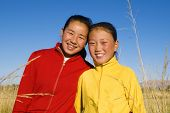Portrait of Mangolian two sisters with beautiful smiling.