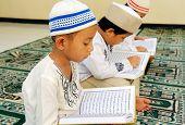 Kids reading Koran