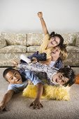 Group of children playing on the living room floor