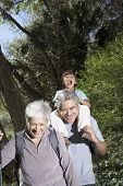 Hispanic grandparents and grandson on nature walk