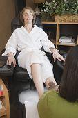 Woman receiving spa pedicure