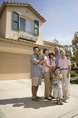 Multi-generational Asian family in driveway