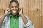 African man listening to music and smiling