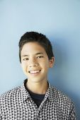 Studio shot of Asian boy smiling