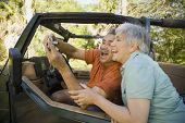 stock photo of four-wheel drive  - Senior Hispanic couple taking self - JPG