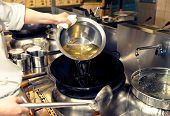 Chef is pouring cooking oil in wok, toned