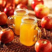 mason jars filled with hot apple cider