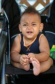 African American Latin toddler in stroller