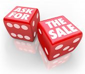 picture of dice  - Ask for the Sale words on two red dice to illustrate taking a chance to press a customer to close a deal and buy or purchase - JPG