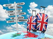 Travel concept. Suitcases and signpost what to visit in UK. 3d