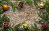 holiday decoration snow, bells, green branch and pine cones on wooden frozen table, christmas backg