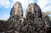 Ancient ruin of the Bayon temple,  with the four sided face sculptures , Angkor Wat Cambodia