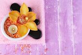 stock photo of salt-bowl  - Still life with beautiful blooming orchid flower - JPG