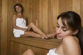 Two Hispanic women in sauna