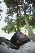 Close up of African man laying in forest