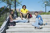 Multi-ethnic college students sitting on steps