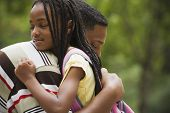stock photo of pre-adolescent child  - Close up of African father and daughter hugging - JPG