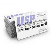 Unique Selling Proposition USP words on a stack of business cards and the words It's Your Calling