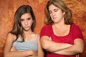 Teenager problems - Angry teenage girl and her sad and worried mother
