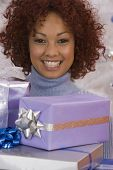 African woman holding Christmas gifts