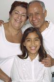 Portrait of Hispanic grandparents and granddaughter