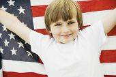 Boy holding up American flag