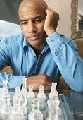 Mixed Race man playing chess