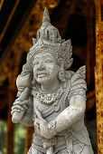 Stone sculpture of Balinese Hindu god inside the Tirta Empul Temple.