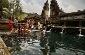 SEPTEMBER 18, 2014 - BALI, INDONESIA: Devotees bathe in the temple pool of Pura Tirta Empul in a cleansing and purification ceremony. Hinduism is the religion of the Balinese people.