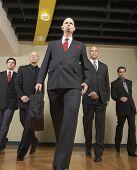 Multi-ethnic businessmen walking in formation