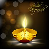 Illustration of illuminated oil lit lamp of golden colour with beautiful text of shubh deepawali in