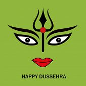Illustration of Goddess Durga face with big eyes, black trident and  stylish text on green background.