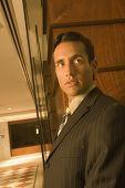 Hispanic businessman looking sideways