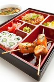 Japanese Meal in a Box - Salad, Skewered Salmon and Sushi Roll and Dessert