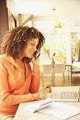 African American woman paying bills
