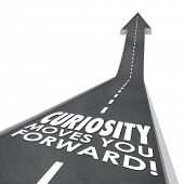 Curiosity Moves You Forward words on a road to illustrate the endless quest for knowledge, information and insight