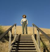 African American female Park Ranger at top of steps