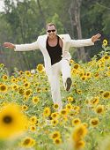 Man dancing in flower patch