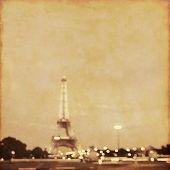 Defocused image of Paris with bokeh.Grunge and retro style.