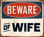 Vintage Metal Sign - Beware of Wife - Vector EPS10. Grunge effects can be easily removed for a brand new, clean design.
